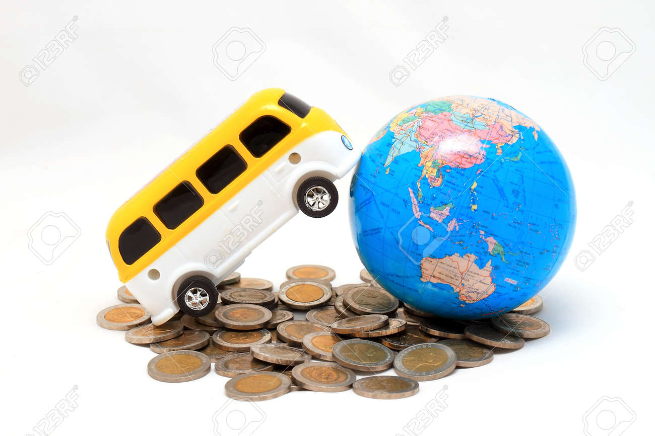 Globe and car on the pile of coins - isolated Stock Photo - 8545920