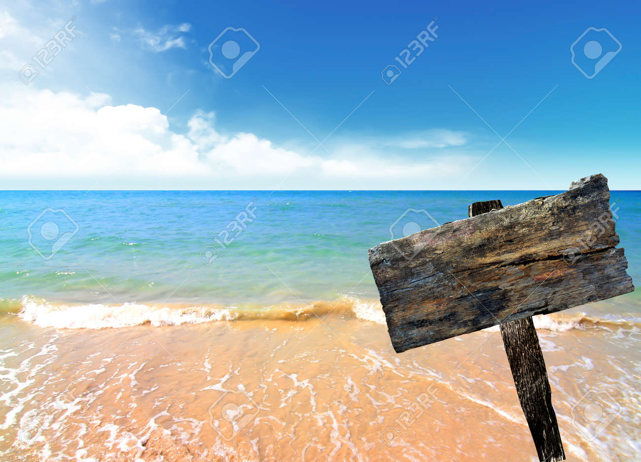 wood sign on beach and sea Stock Photo - 9440376