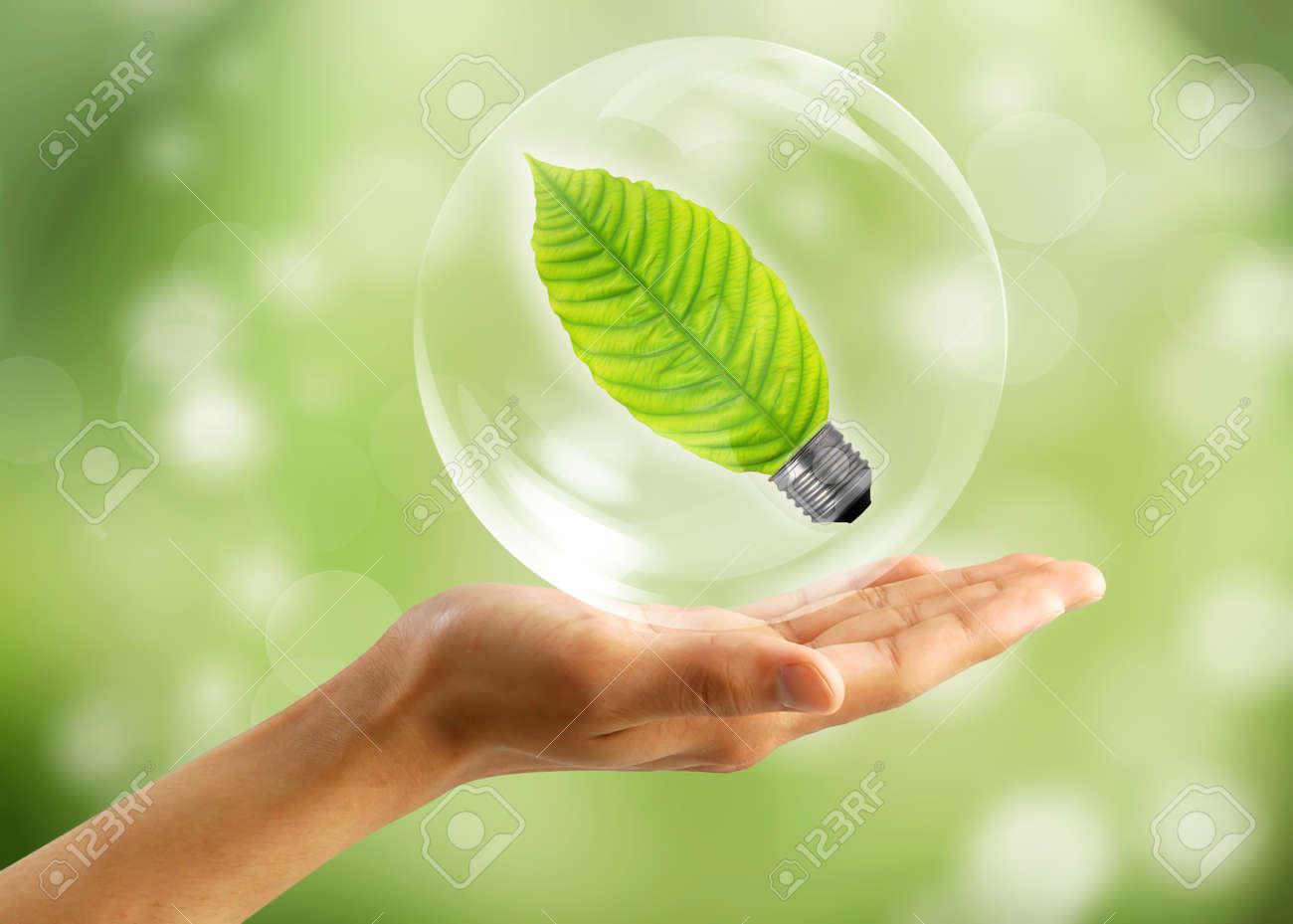Eco concept : Hand with leaf in bubbles Stock Photo - 10226297