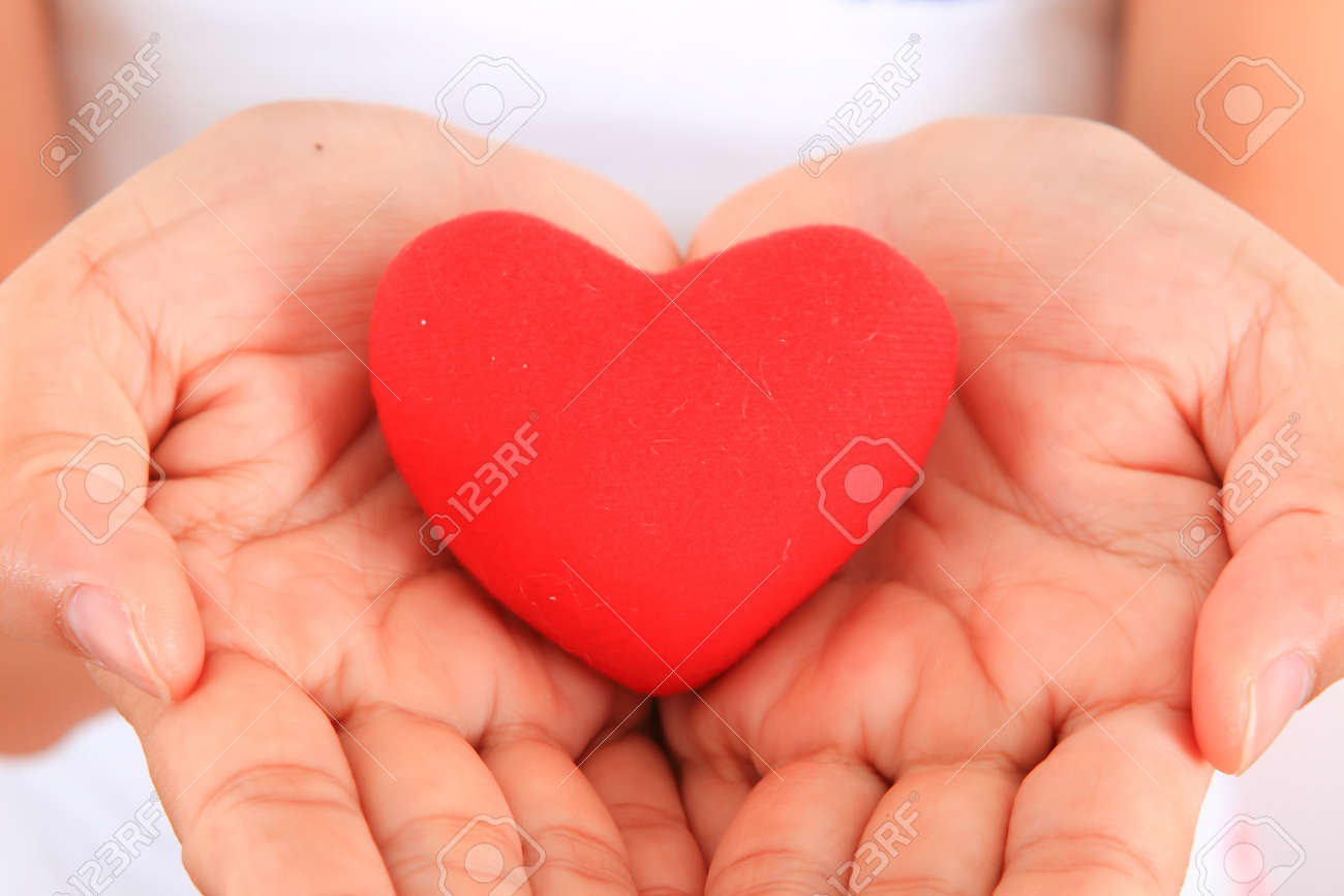 Female hands with red heart Stock Photo - 11893422