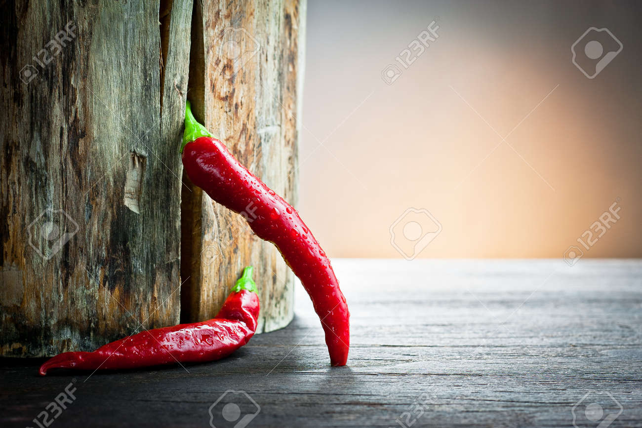 red hot chilli pepper on wood - 12122756