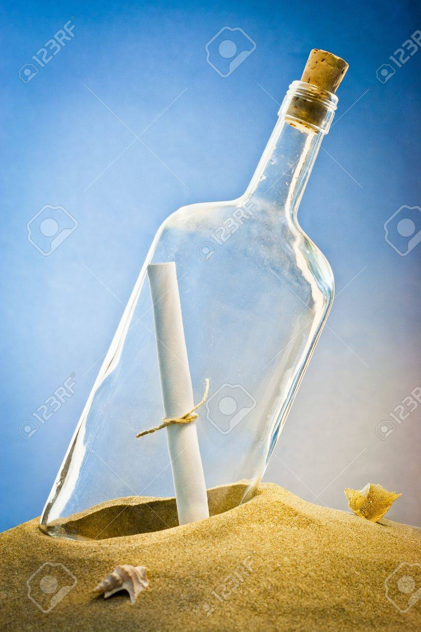 message in bottle on sand - 12122679