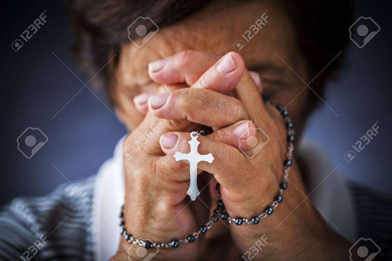 Praying with a rosary - 15587022
