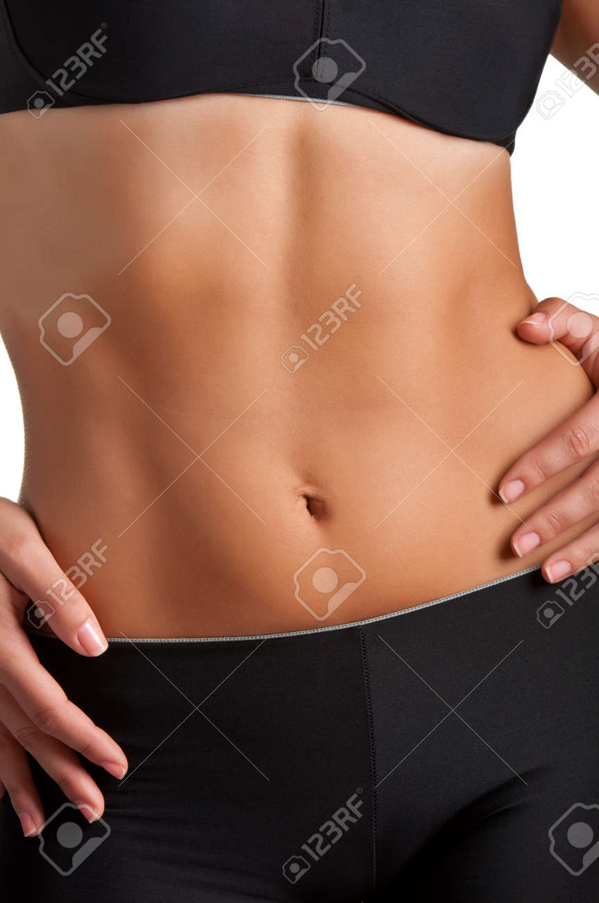 Closeup of a fit woman's abs isolated on a white background Stock Photo - 16128848