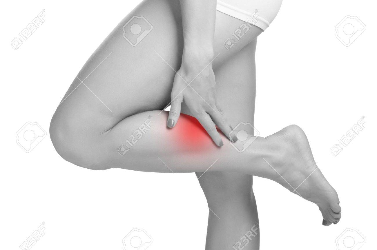 Female with pain in her lower leg, isolated in white Stock Photo - 17450147