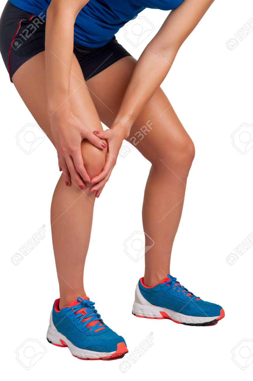 Young woman with pain in her knee, isolated in white Stock Photo - 17817395