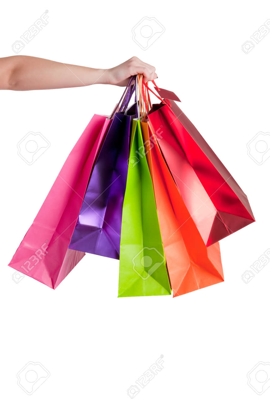 Woman Carrying Shopping Bags isolated in a white background Stock Photo - 17816514