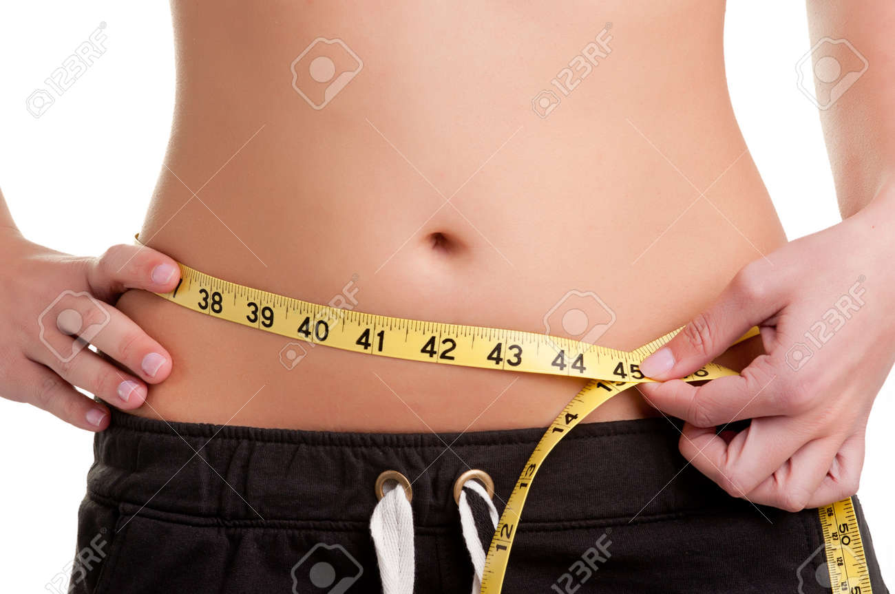 Woman measuring her waist with a yellow measuring tape, isolated in white Stock Photo - 19116957