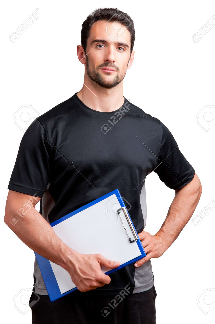 Personal Trainer, with a pad in his hand, isolated in white Stock Photo - 19802292