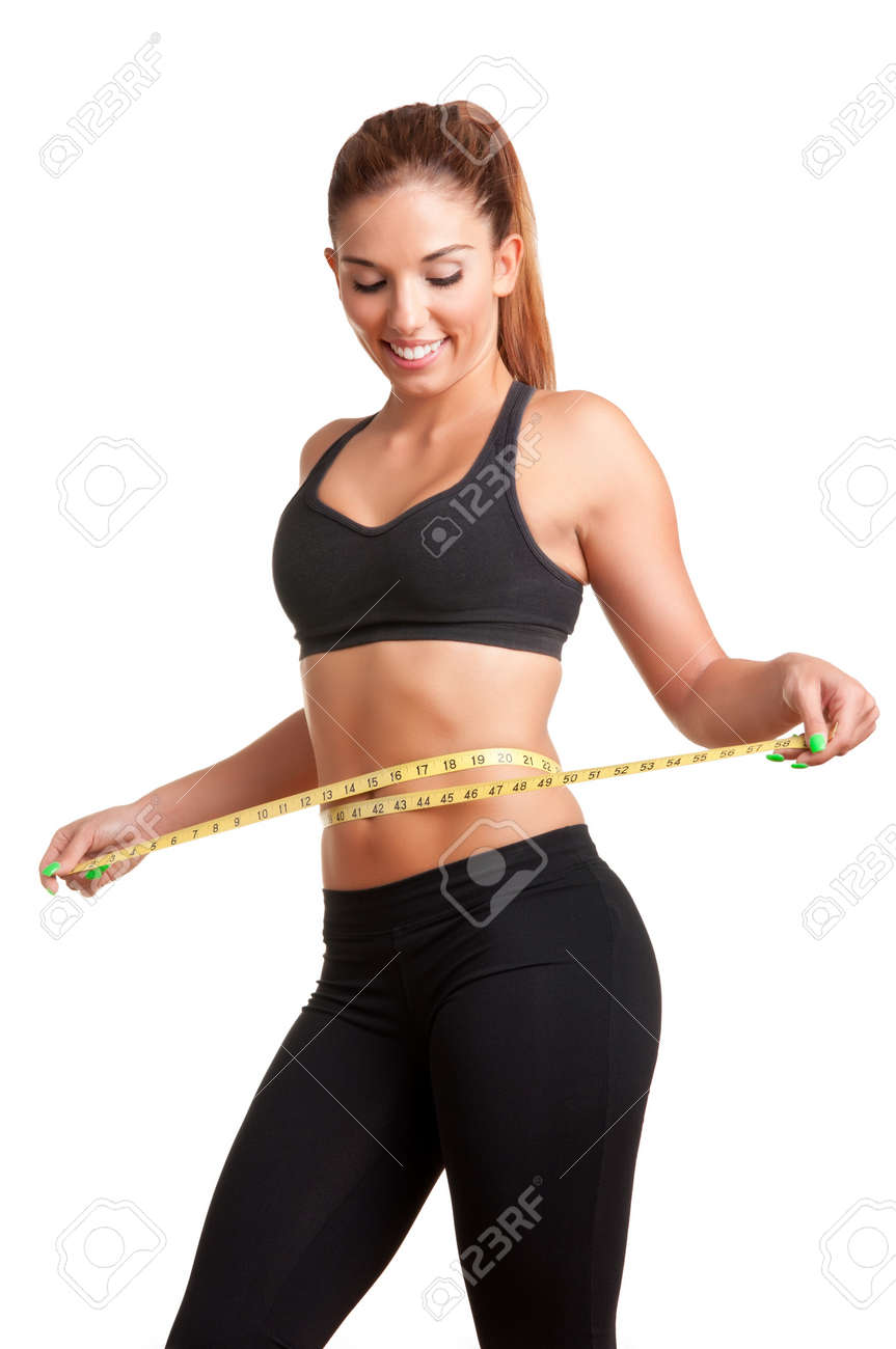 Woman measuring her waist with a yellow measuring tape, isolated in white Stock Photo - 21165751
