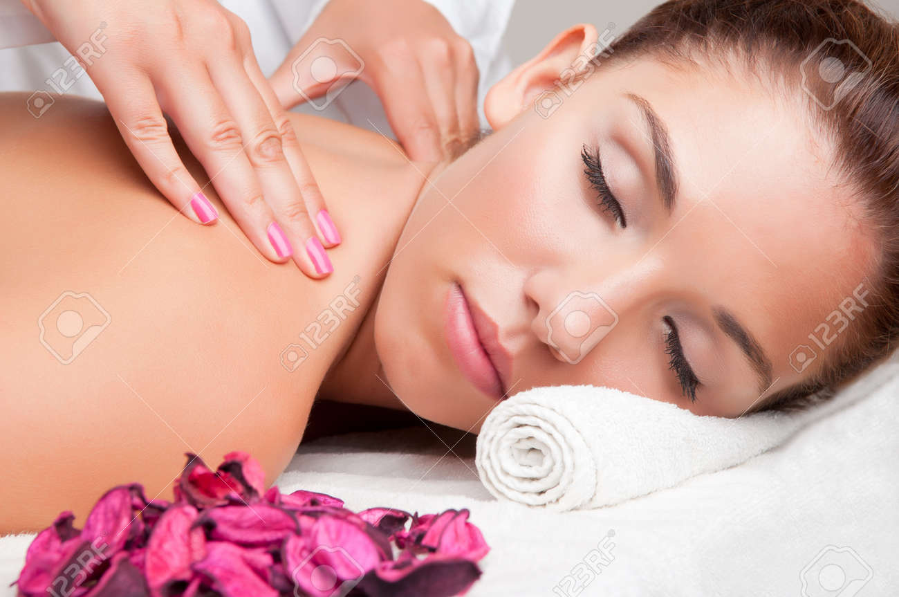Young woman lying in a spa ready to get a massage Stock Photo - 21382864
