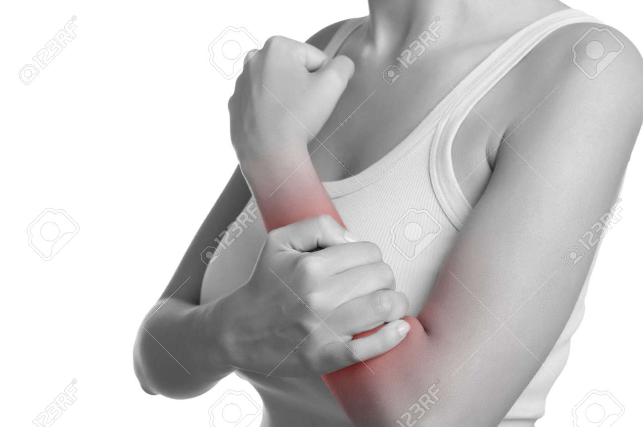 Female with pain in her forearm. Black and White with a red spot around the painful area. Isolated. Stock Photo - 22157201