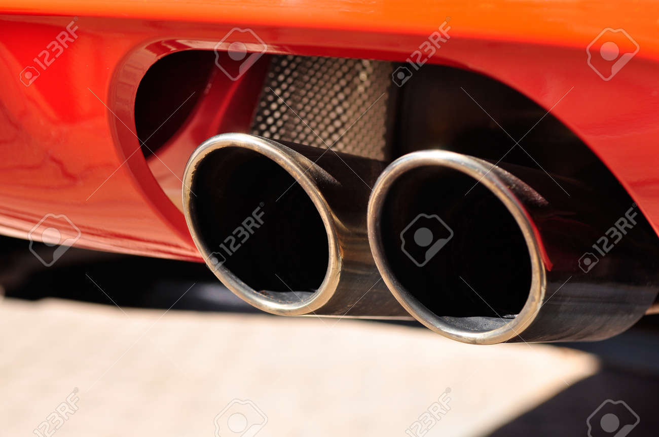 Close up of a red car dual exhaust pipe Stock Photo - 23319162