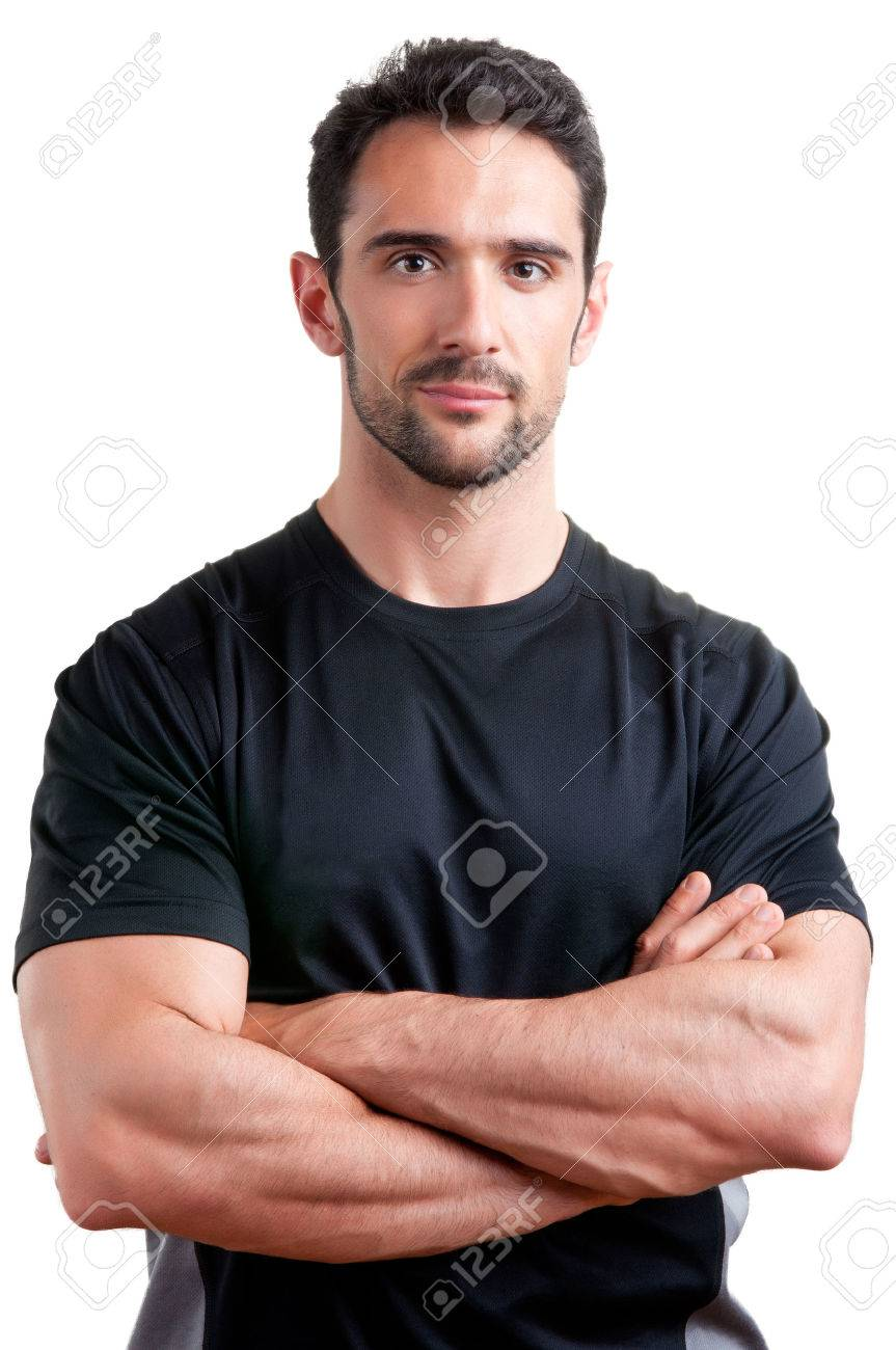 Personal trainer with is arms crossed, isolated in white Stock Photo - 23325199