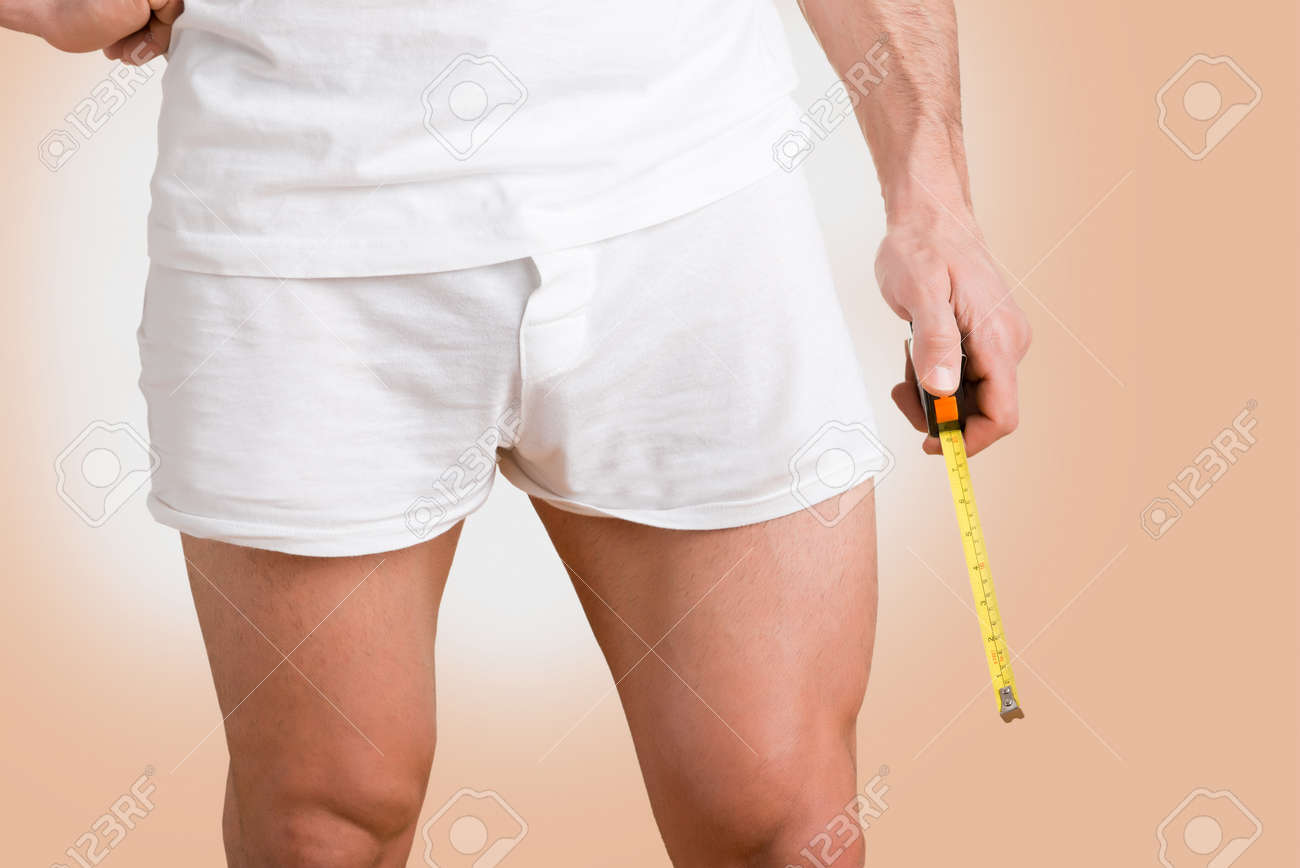 Concept of a man with a big penis with a measuring tape in the hand Stock Photo - 28455831