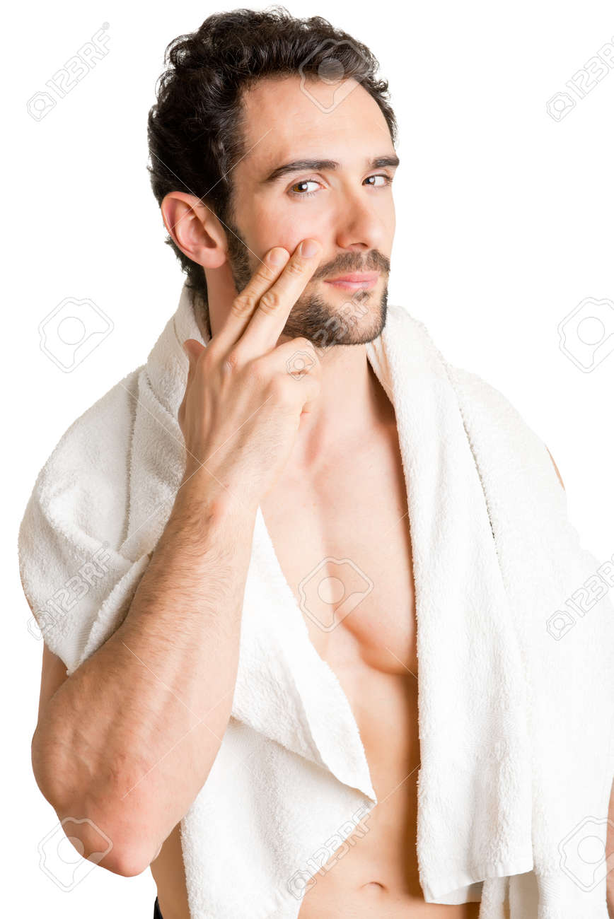 Male applying moisturizer to her face, isolated in white Stock Photo - 29680745