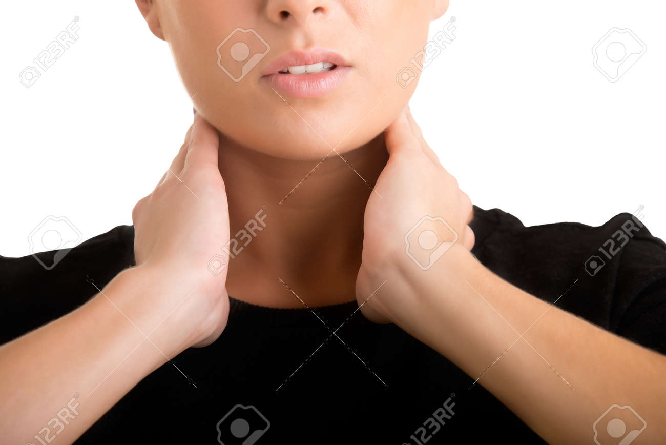 Woman with a sore throat holding her neck Stock Photo - 34703326