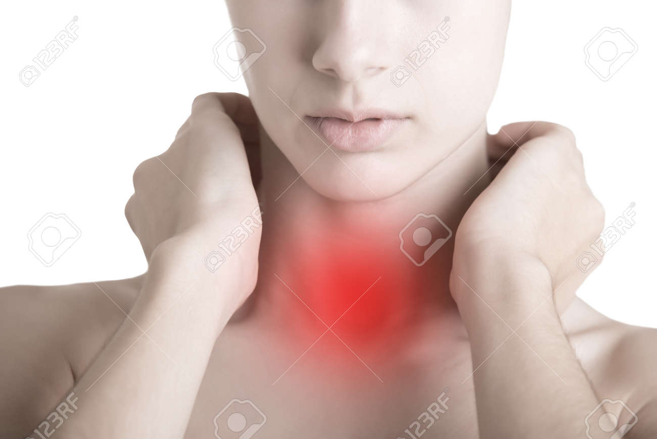 Woman with a sore throat holding her neck Stock Photo - 34702940