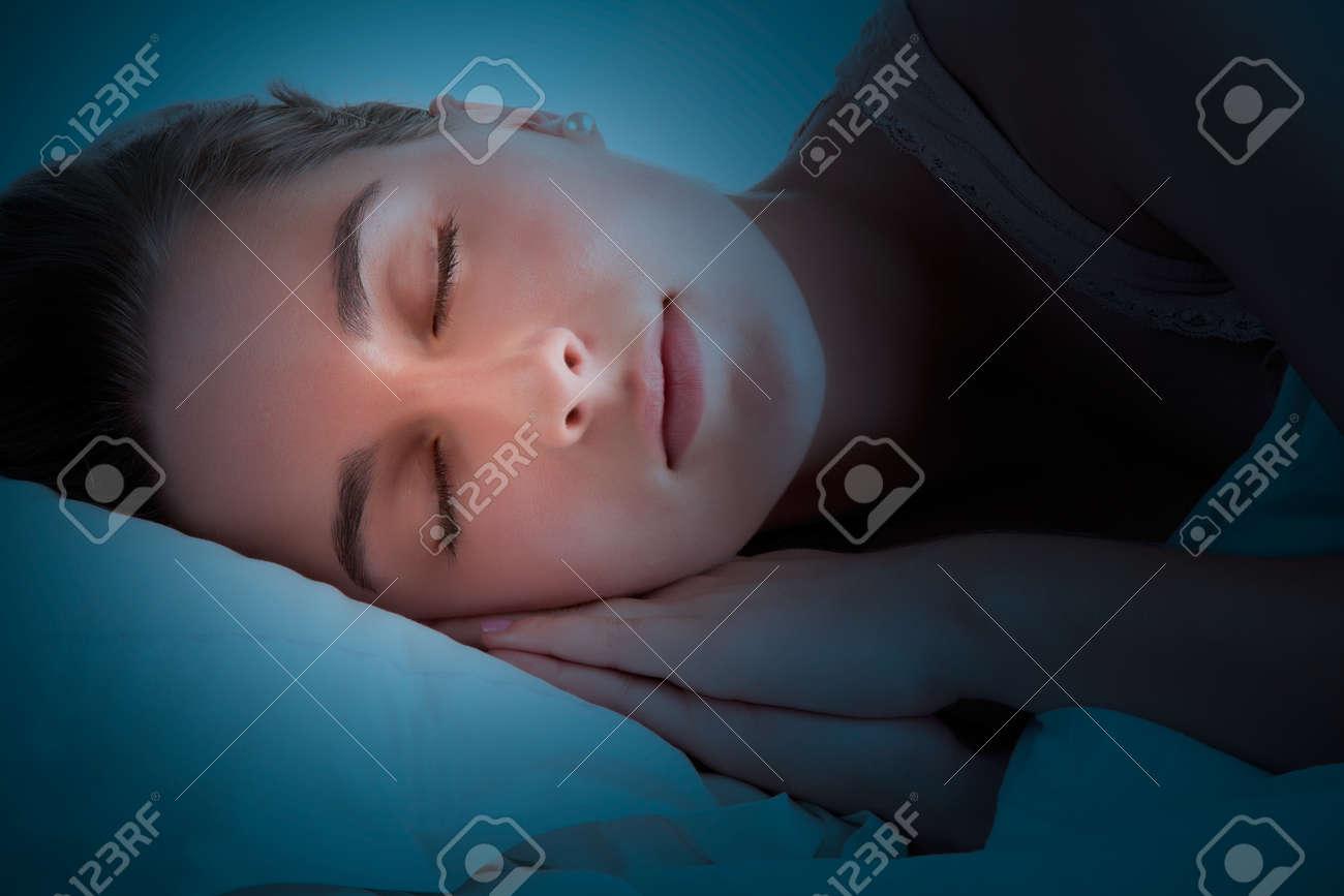 Woman sleeping in the dark Stock Photo - 41793128