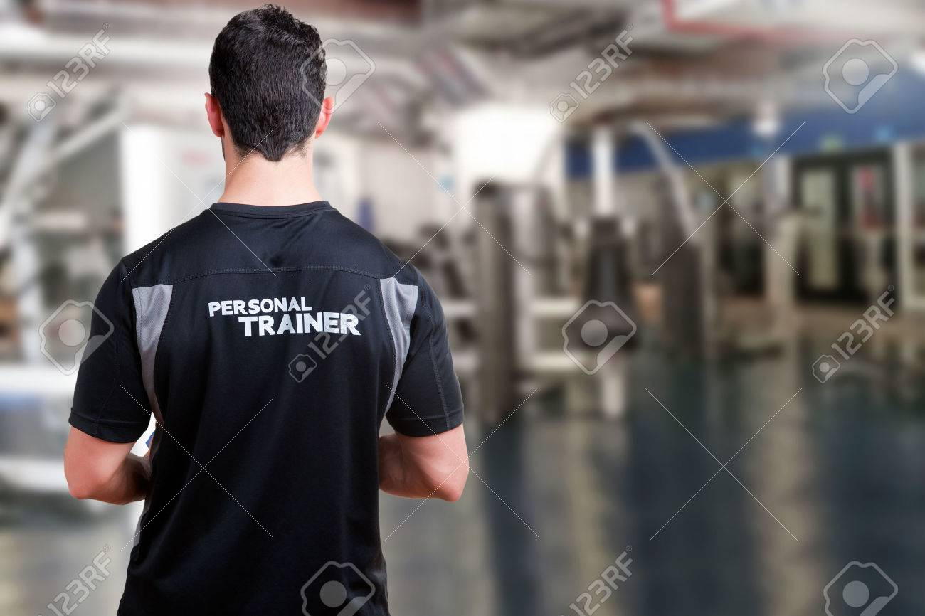 Back of a Personal Trainer in a gym Stock Photo - 46069253