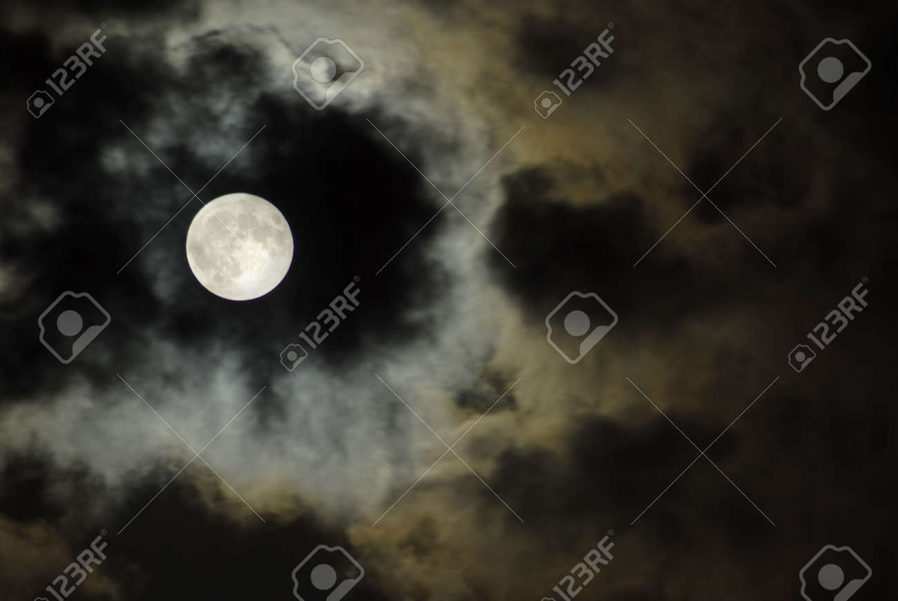 big moon over the clouds in a dark night Stock Photo - 890317