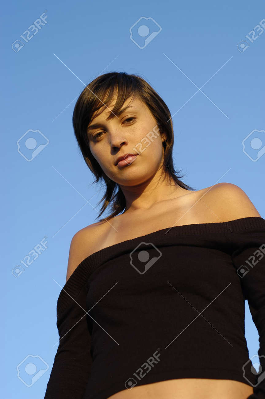young woman posing against the blue sky Stock Photo - 1868553