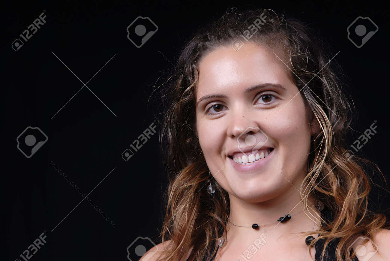 Young casual woman posing in black background Stock Photo - 1876431