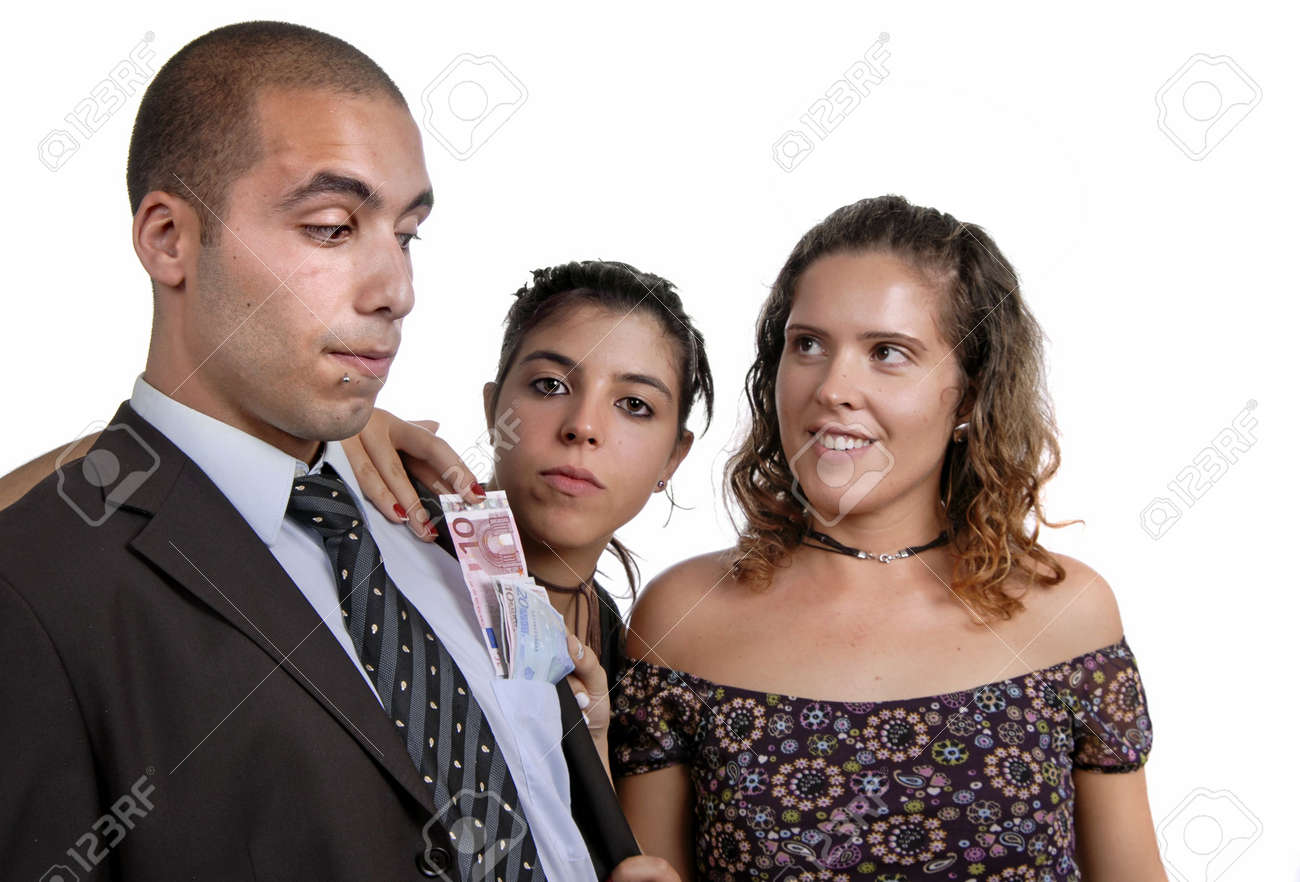 team in studio, woman takes money from man poket Stock Photo - 2326750