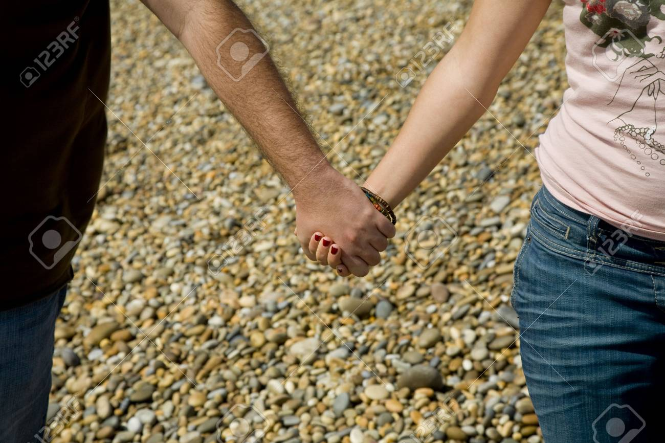 Young couple hands detail at the beach Stock Photo - 4852466