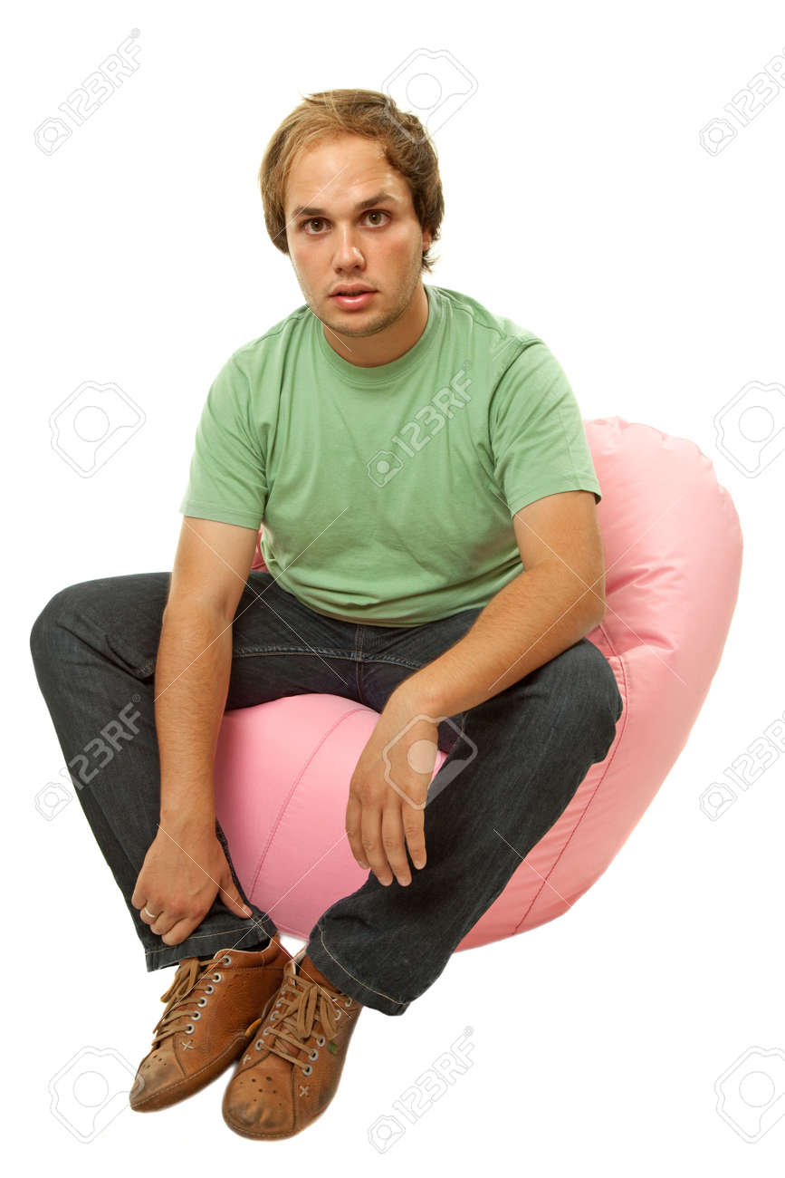 young casual man seated in a small sofa Stock Photo - 6285286