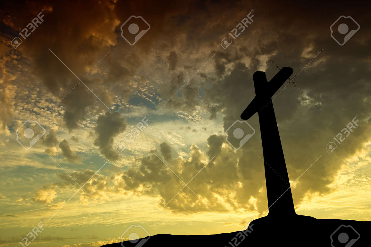 Silhouette of the holy cross on background of storm clouds stock - Cross Sunset Cross Silhouette With The Sunset As Background