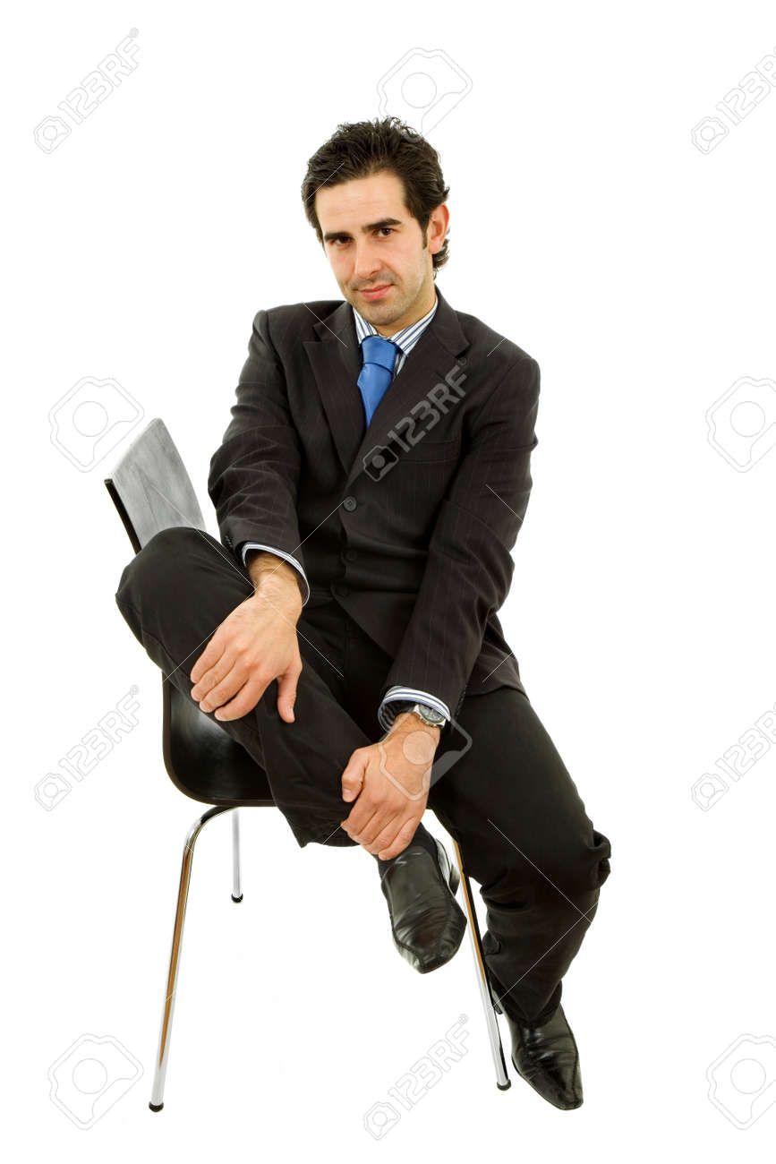 young businessman on a chair, isolated on white Stock Photo - 8941205