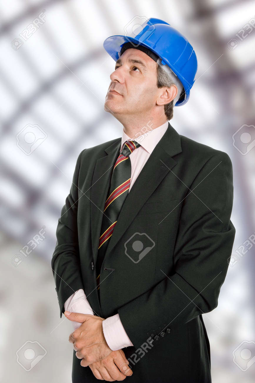 An engineer with blue hat at the office Stock Photo - 10561259