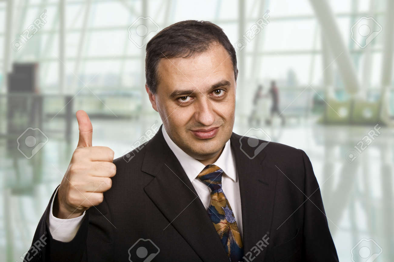 business man going thumbs up at the office Stock Photo - 17213698