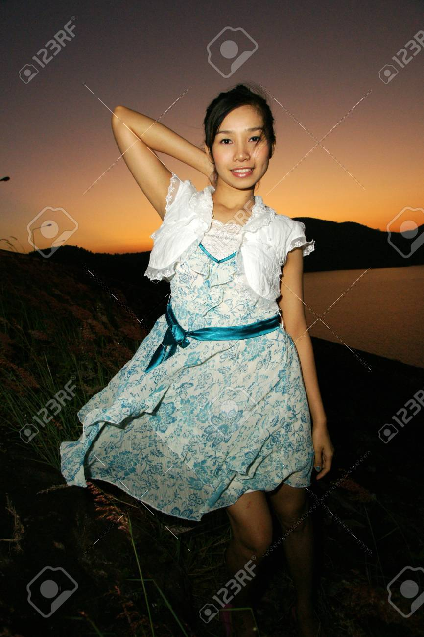 young pretty woman in Beautiful dress with sunset background Stock Photo - 16637522