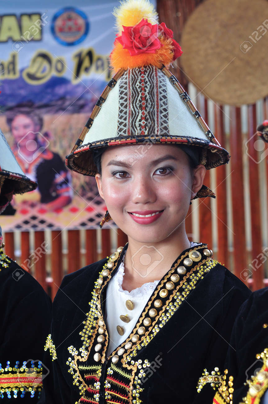 Lovely smiling girl in traditional costume during Harvest Festival, a natives festival from Sabah Borneo Malaysia. - 55990190