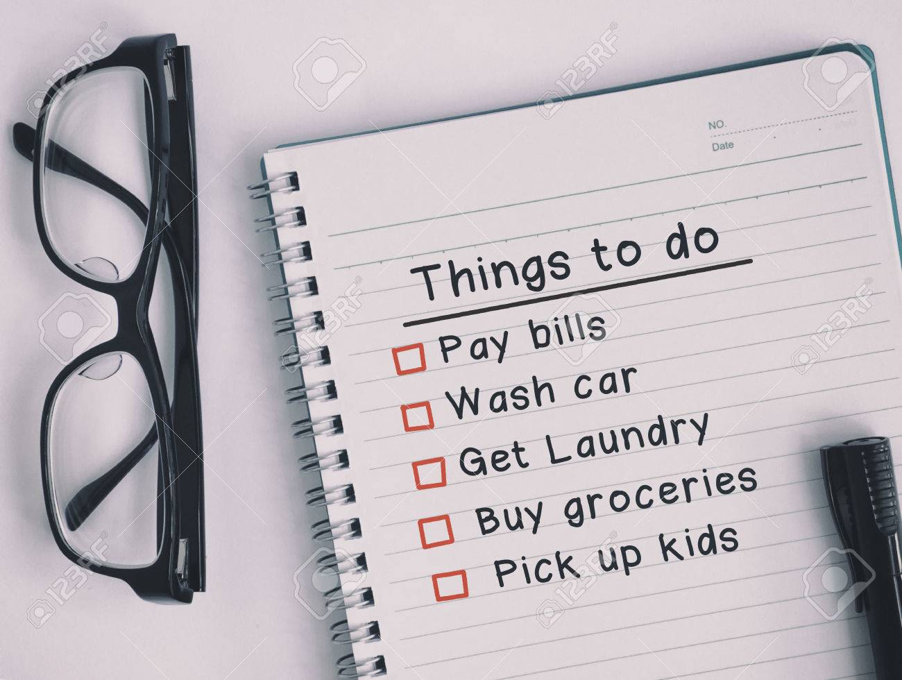 things to do checklist on notepad retro style and analog treatment