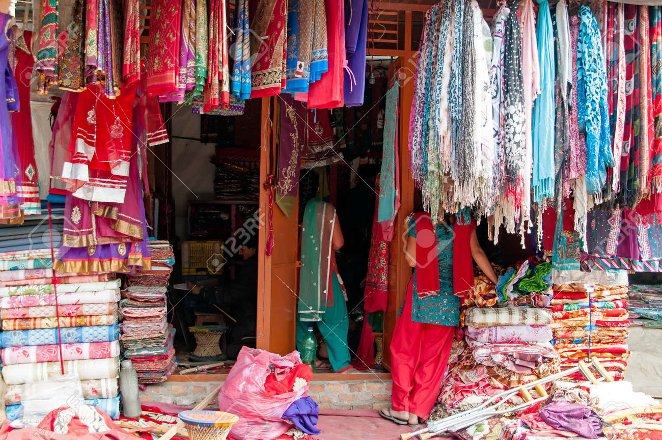 Textile and souvenir shop selling colorful sari, clothes and