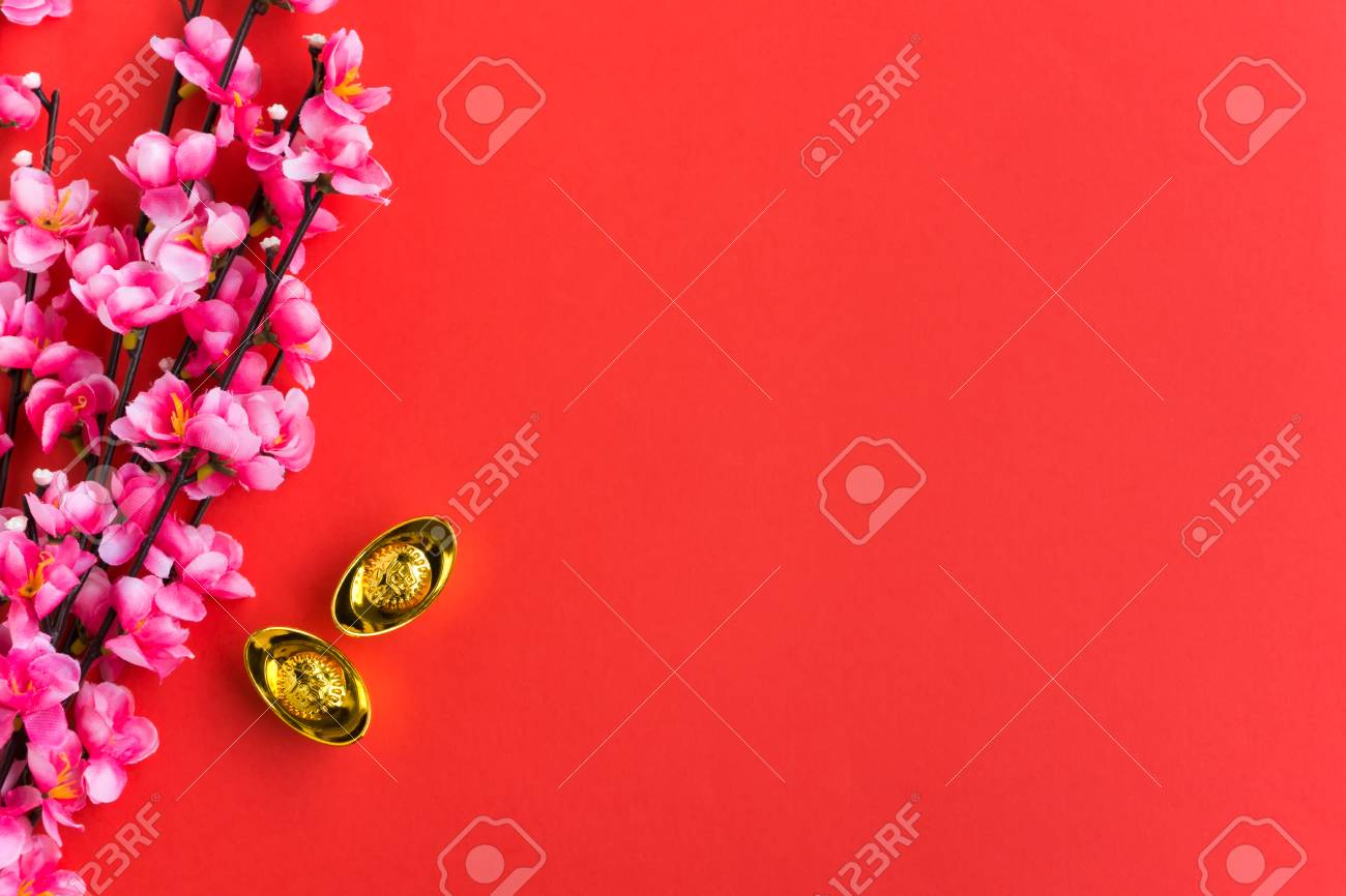 chinese new year background ornaments plum flowers and gold ingots with chinese word happiness and