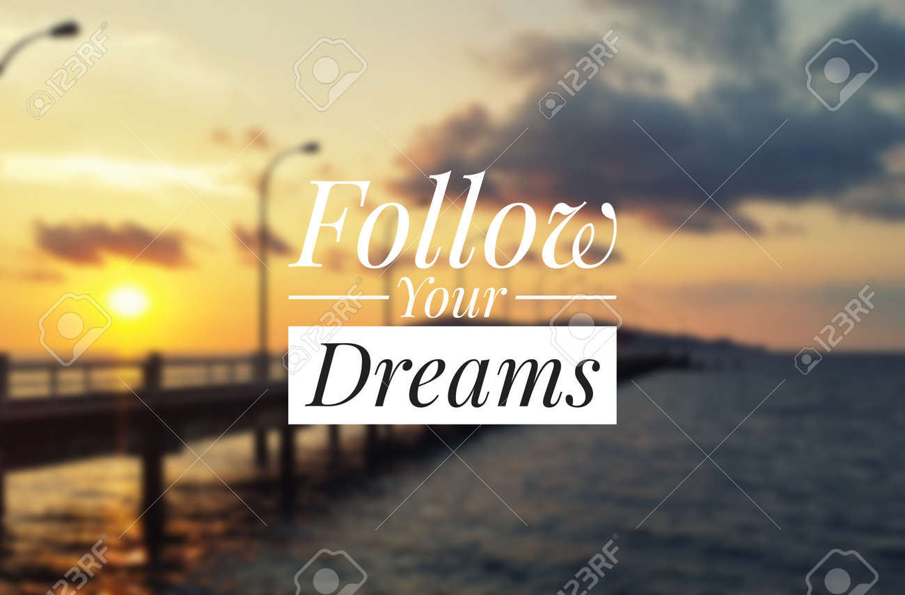 Inspirational Quote Follow Your Dreams Blurry Sunset Background