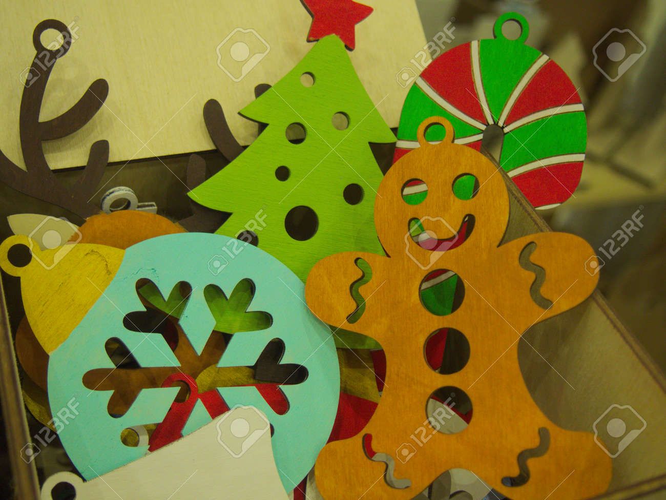 Painted Wooden Gingerbread Man And Snowflake Figurine On A Christmas