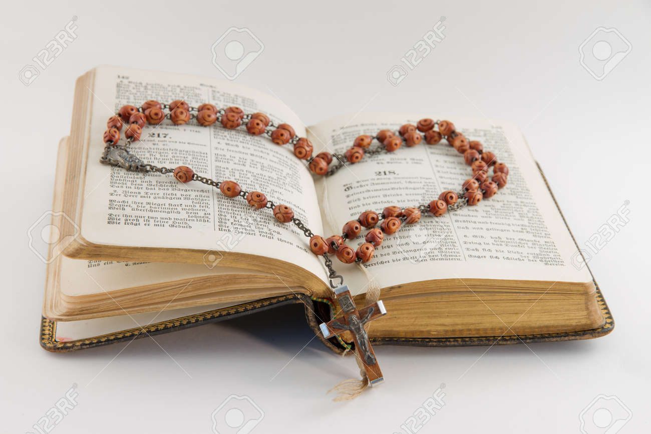 Old hymnal and a rosary Stock Photo - 13555233