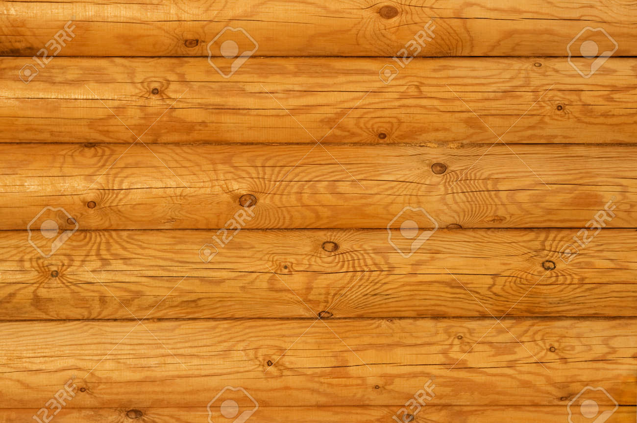 http://previews.123rf.com/images/rumos/rumos1106/rumos110600079/9788088-Wooden-wall-from-logs-in-decline-beams-Stock-Photo.jpg