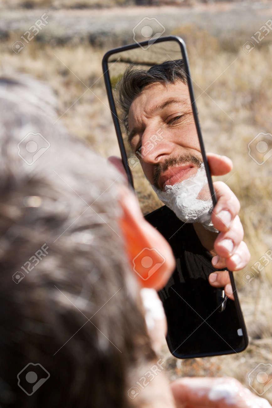 Portrait man shaving outdoor Stock Photo - 10751260
