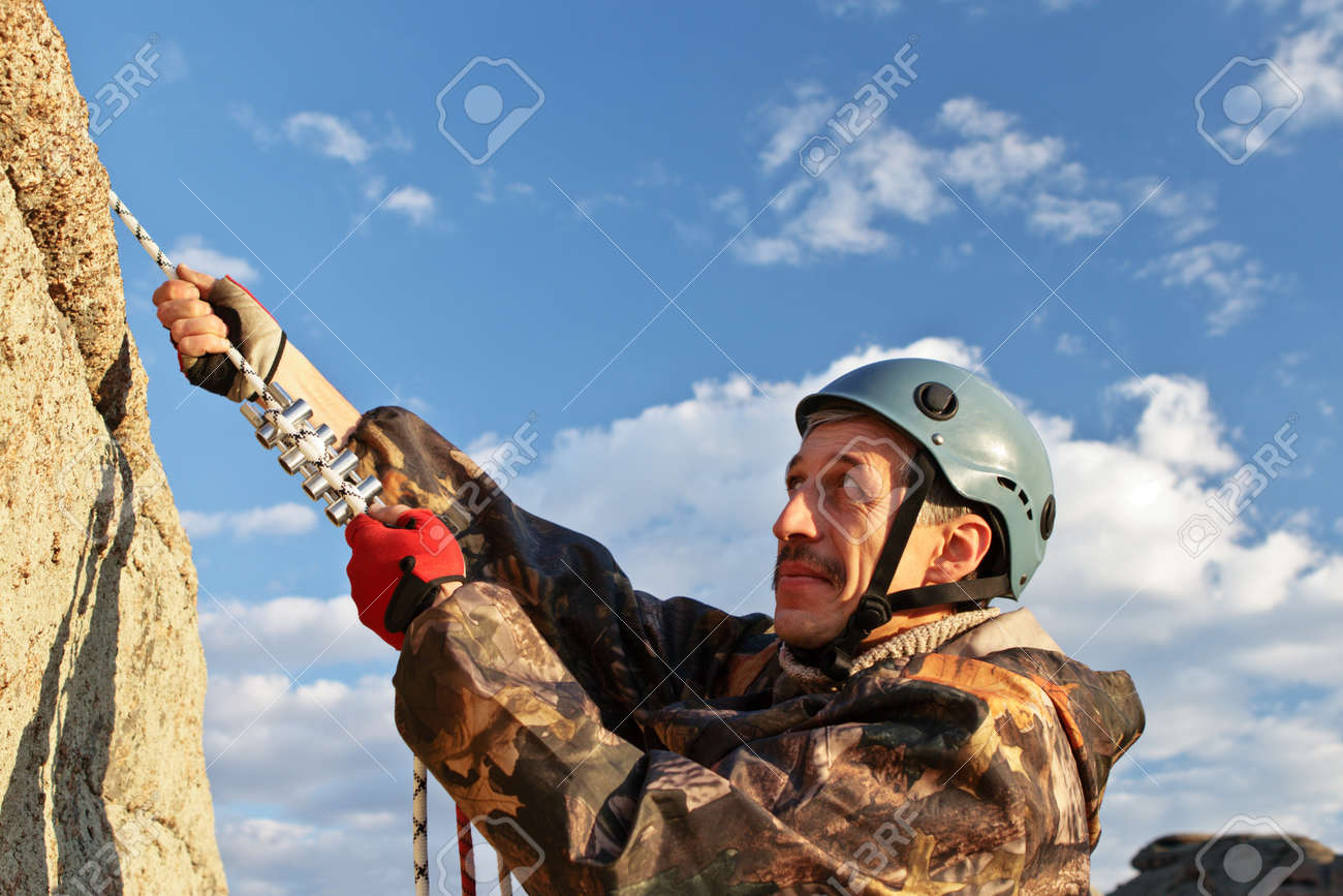 The sportsman moves upwards means of rope Stock Photo - 10842618