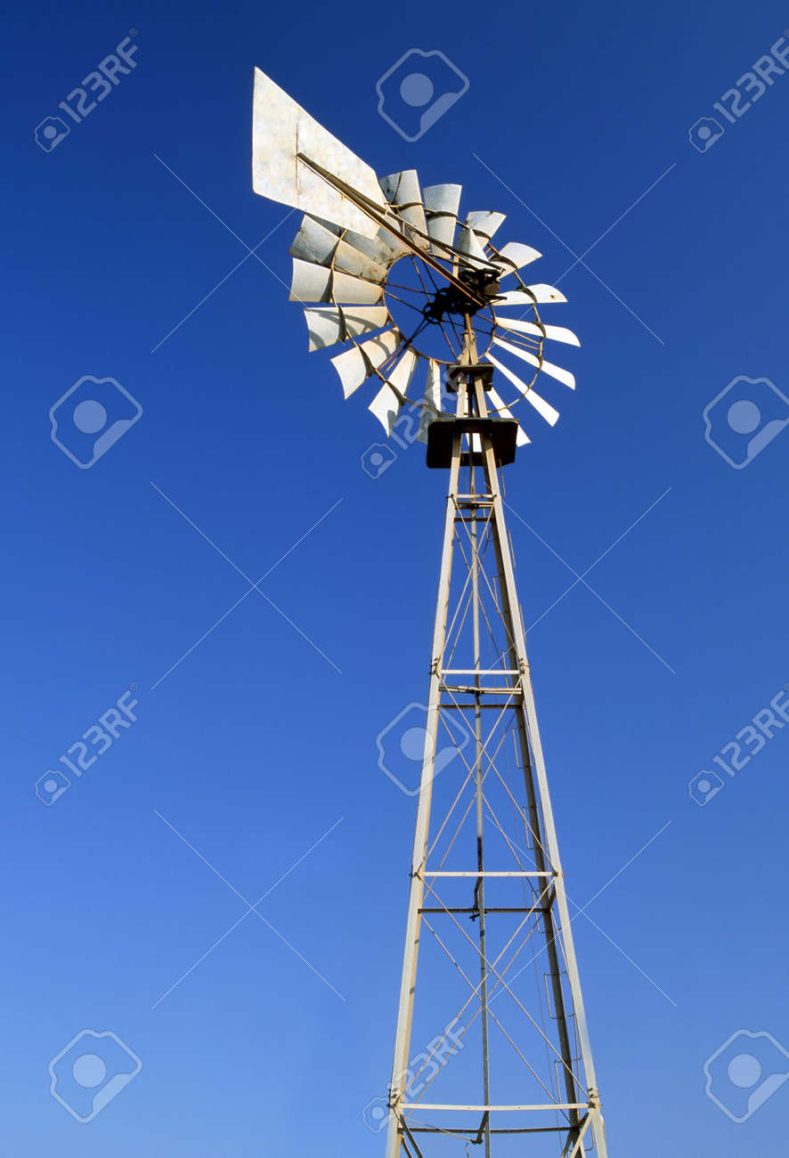 An irrigation wind pump against a blue sky Stock Photo - 4284041