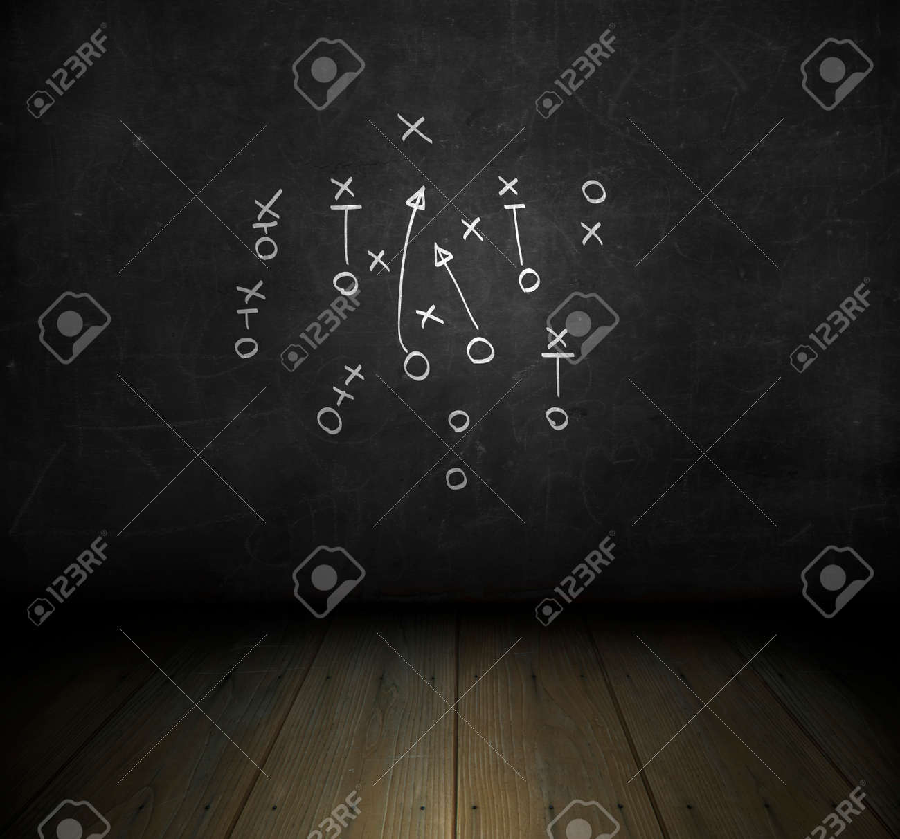 Football play strategy drawn out on a chalk board - 39347894