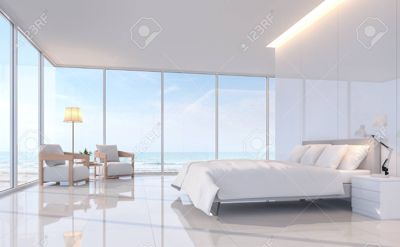 Modern white bedroom with sea view 3d rendering image.There are..