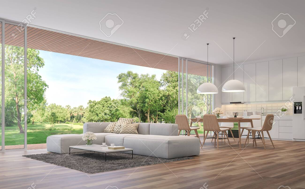 Modern Living, dining room and kitchen with garden view 3d render.The Rooms have wooden floors ,decorate with white furniture,There are large open doors. Overlooks wooden terrace and large garden. - 126735128