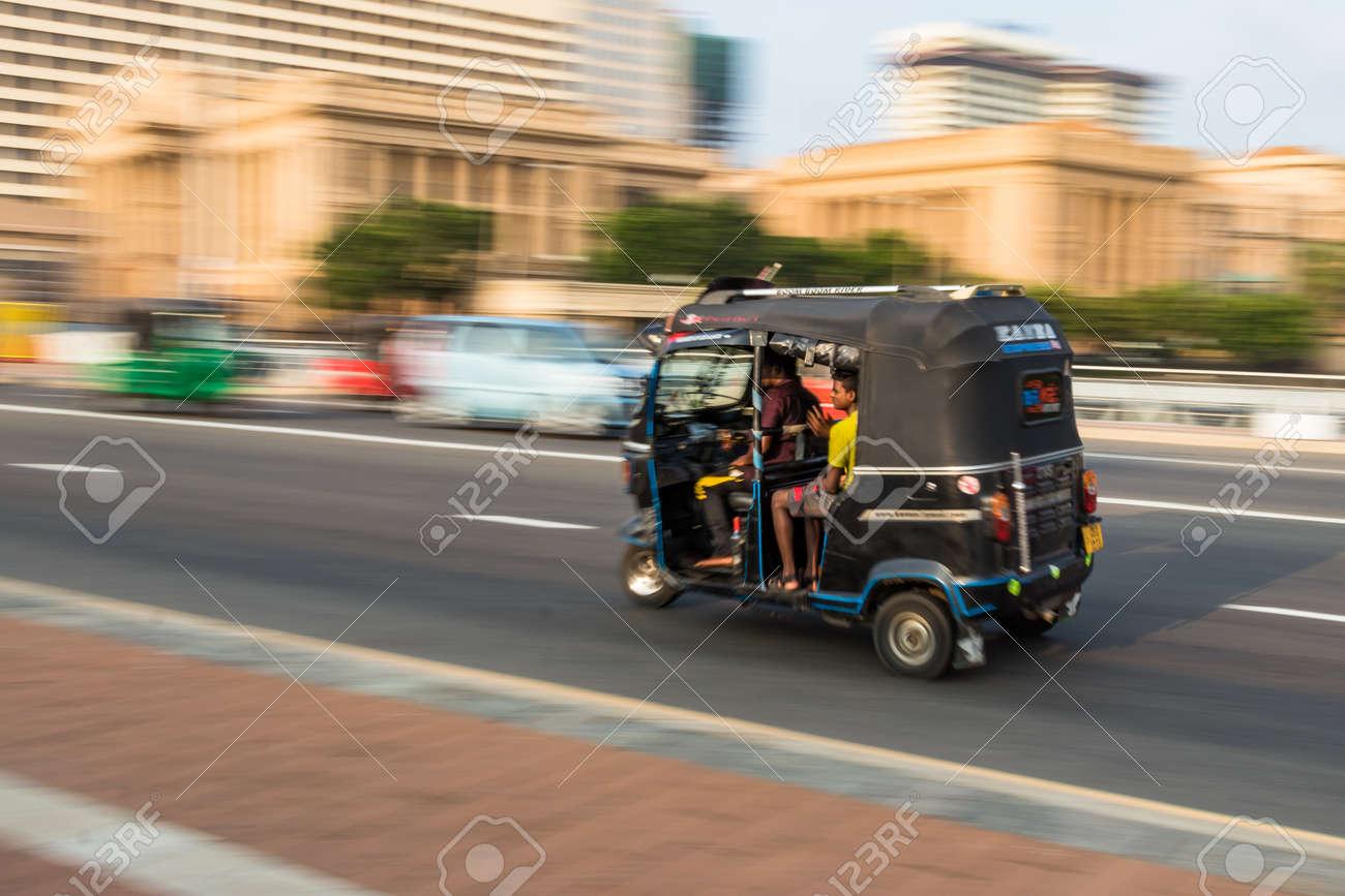 COLOMBO, SRI LANKA - February 19, 2019: A motorcycle Tuk Tuk with passengers, blurry speed motion in Colombo, Sri Lanka. - 150132745